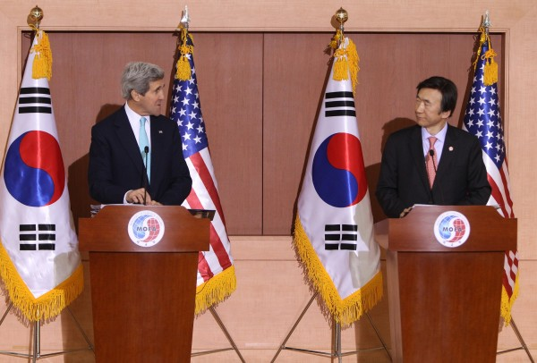Kerry, left, rebuked North Korea for linking a humanitarian issue with military exercises [Xinhua]