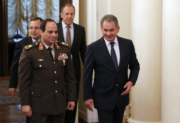 El-Sissi, front left, has looked to strengthen economic and military ties with Russia [AP]