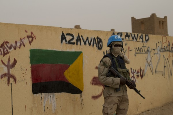 A file photo shows a UN peacekeeper stationed outside a polling station in Bamako. Elections were held last July and August and the new government has been trying to hold peace talks with Tuareg rebels [AP]
