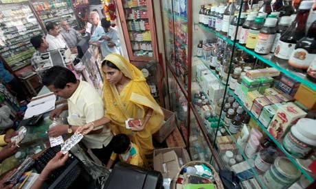 Customers buy medicine at a pharmacy in Mumbai, India [Getty Images]