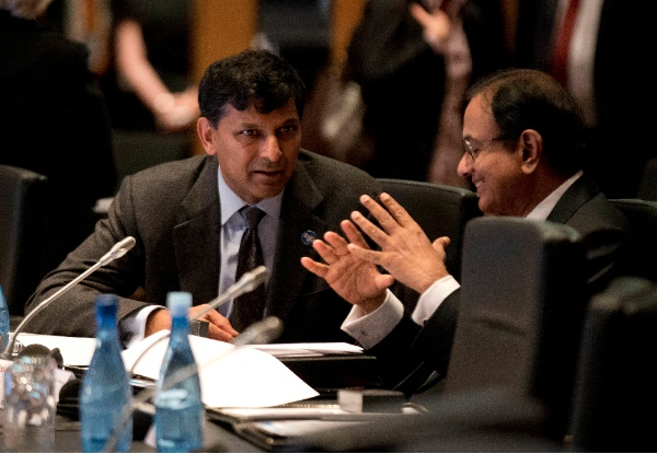 India's Reserve Bank Governor Raghuram Rajan, left, speaks with India's Finance Minister Palaniappam Chidanbarum during the opening session of the G20 Finance Ministers and Central Bank Governors meeting in Sydney, Australia, Saturday, Feb. 22, 2014 [AP]