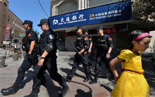 File photo of Chinese security personnel patrolling the restive region of Xinjiang where Uighur separatists say they want their own state [Getty Images]