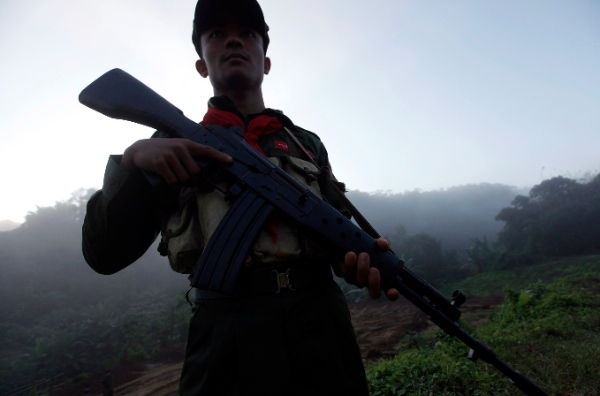 A soldier of the All Burma Students' Democratic Front stands guard during a ceremony to mark the ABSDF's 25th anniversary at Janghtung Lahkum-Bum, near Laiza, a border town of China and Myanmar, Kachin State, northern Myanmar, Friday, Nov. 1, 2013 [AP]