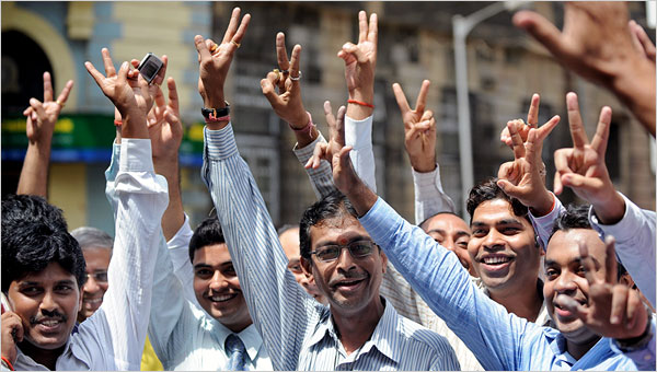 File photo of Indian brokers celebrating outside the Bombay Stock Exchange in Mumbai, India [Getty Images]