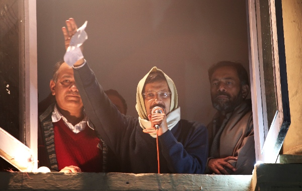 Anti-graft activist Arvind Kejriwal, center, addresses his supporters with his resignation letter in his hand at Aam Aadmi Party, or Common Man's Party, headquarters in New Delhi, India, Friday, Feb. 14, 2014 [AP]