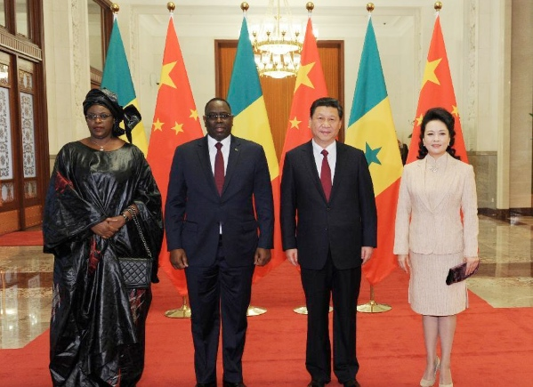 Chinese President Xi Jinping (2nd R) and his wife Peng Liyuan (R) with visiting Senegalese President Macky Sall (2nd L) and his wife Mareme Faye Sall during a welcome ceremony in Beijing, Feb. 20, 2014 [Xinhua]