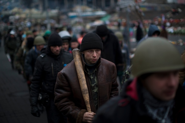 Anti-Yanukovych protesters march in the Independence Square, the epicenter of the country's current unrest, in Kiev, Ukraine, Wednesday, Feb. 26, 2014 [AP]
