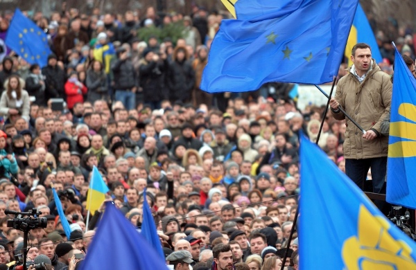 Ukrainian opposition leader and boxing champion Vitali Klitschko (R) joins thousands of protesters for a pro-EU opposition rally at Independence Square in Kiev in December 2013 [Getty Images]