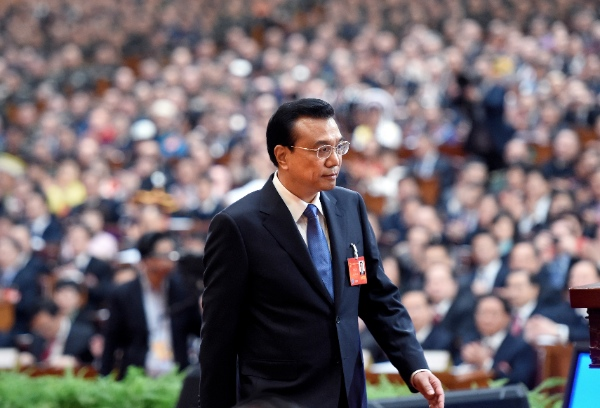 Chinese Premier Li Keqiang delivers the government work report during the opening meeting of the second session of the 12th National People's Congress (NPC) at the Great Hall of the People in Beijing, capital of China, March 5, 2014 [Xinhua]