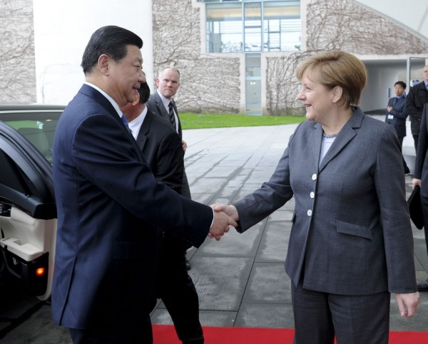 File Photo: Chinese President Xi Jinping with German Chancellor Angela Merkel in Berlin, Germany [Xinhua]