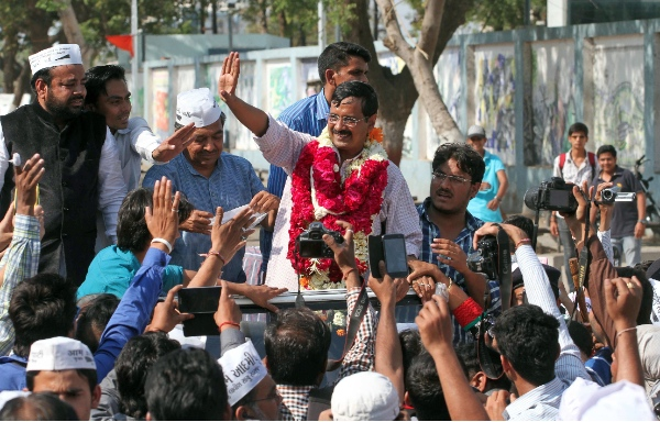 Aam Aadmi Party, or Common Man Party, leader and anti-graft activist Arvind Kejriwal, center, greet supporters during an election rally in Ahmadabad, India, Saturday, March 8, 2014 [AP]
