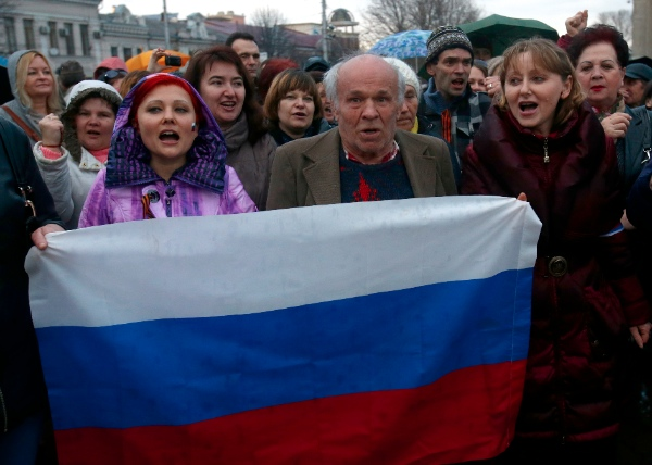 Pro-Russian supporters chant slogans during a rally at a central square in Simferopol, Ukraine on 5 March, 2014 [AP]