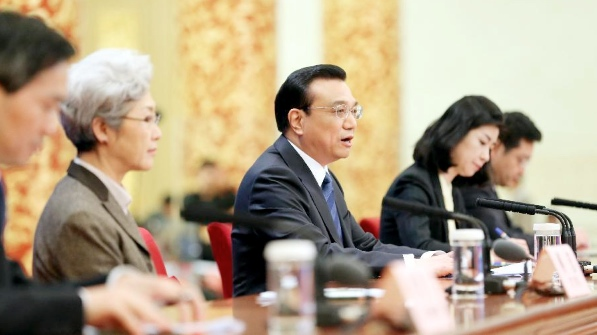 Chinese Premier Li Keqiang (C) speaks at a press conference after the closing meeting of the second annual session of China's 12th National People's Congress (NPC) at the Great Hall of the People in Beijing, capital of China, March 13, 2014 [Xinhua]