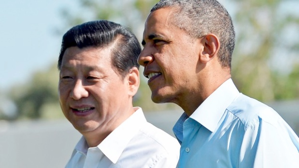File photo of Chinese President Xi Jinping (left) with his American counterpart Barack Obama [Getty Images]