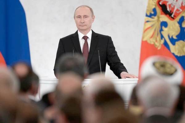 Putin addresses members of Russian Parliament, Federation Council members, heads of Russian regions and civil society representatives in the Kremlin on 18 March 2014 [PPIO]