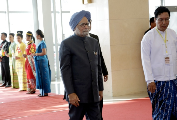 Indian Prime Minister Manmohan Singh (C) arrives to attend the opening ceremony of BIMSTEC Summit at Myanmar International Convention Center (MICC) in Nay Pyi Taw, Myanmar, March 4, 2014 [Xinhua]