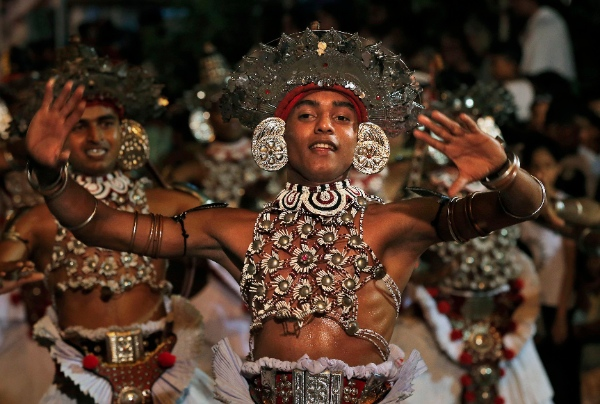 In this Friday, Feb. 14, 2014 photo, a Sri Lankan traditional dancer performs during the annual Buddhist temple festival, known as Navam Perahera, in Colombo, Sri Lanka [AP]