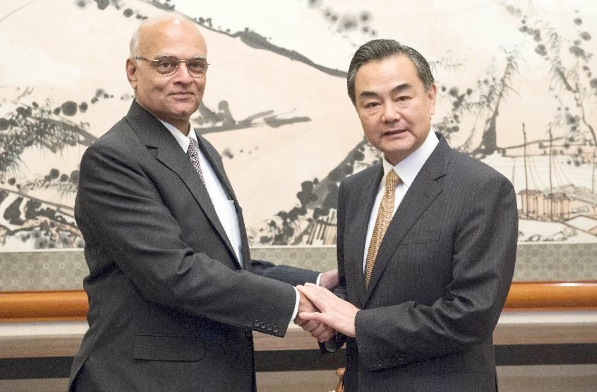 File photo of Indian NSA Shivshankar Menon (left) and Chinese Foreign Minister Wang Yi [Xinhua]