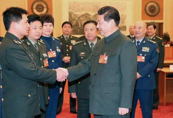 talks with a deputy to the 12th National People's Congress (NPC) from the People's Liberation Army (PLA) in Beijing, capital of China, March 11, 2014 [Xinhua]