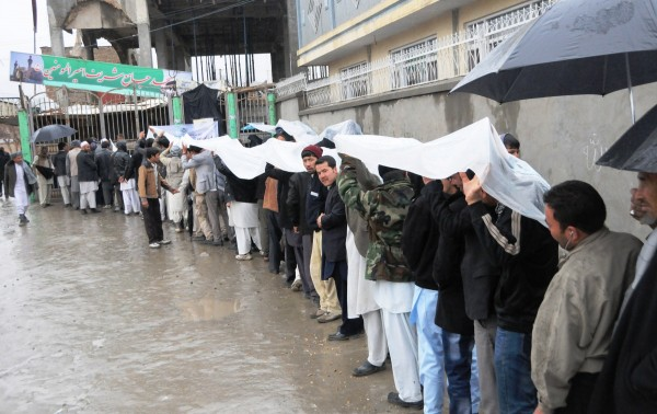 Nearly 60 per cent of eligible voters braved the rain and threat of violence to vote in Afghanistan elections on Saturday [Xinhua]