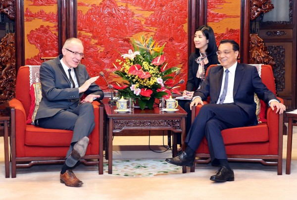 Li, right, said that Beijing has made economic reform and increasing flexibility a national priority [Xinhua]