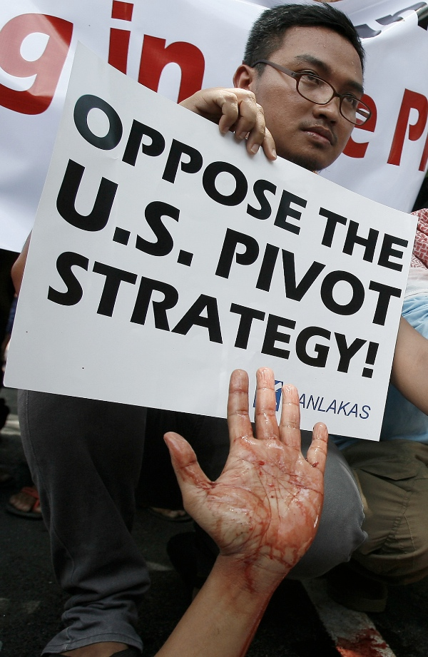 An activist shows a blood-stained hand during a protest rally in Manila, the Philippines on April 25, 2014. The protesters denounce the upcoming state visit of U.S. President Barack Obama to witness the signing of the Agreement on Enhanced Defense Cooperation that would bring back US military bases in the country [Xinhua]