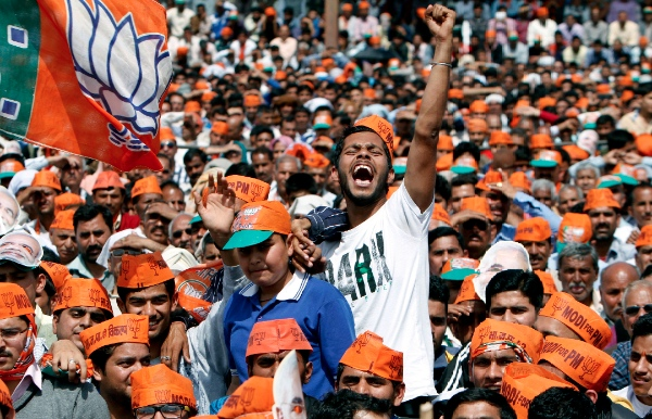 Supporters of India's right wing nationalist Bharatiya Janata Party in Hiranagar 55 kilometers (34 miles) from Jammu, India, Wednesday, March 26, 2014 [AP]