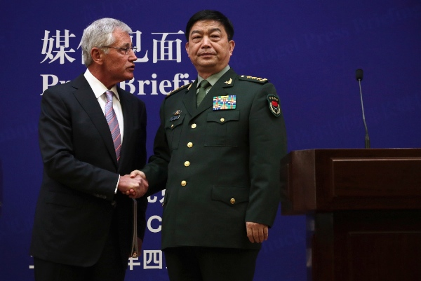 U.S. Defense Secretary Chuck Hagel, left, and Chinese Defense Minister Chang Wanquan shake hands at the end of a joint news conference at the Chinese Defense Ministry headquarters in Beijing, China Tuesday, April 8, 2014 [AP]