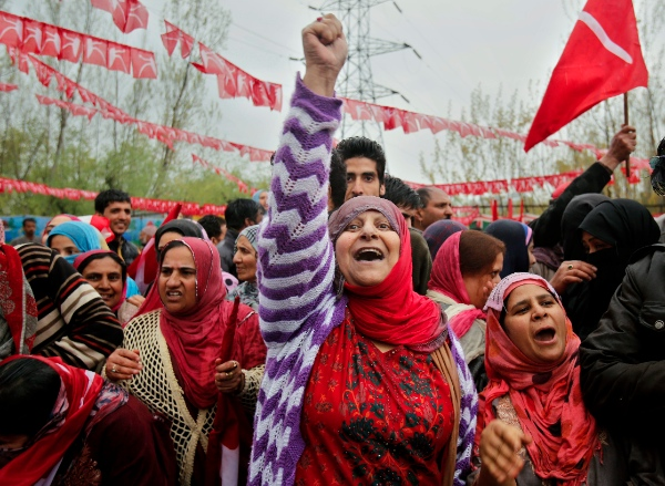 A Kashmiri supporter shouts slogans at an election rally on the outskirts of Srinagar, India, Wednesday, April 16, 2014 [AP]