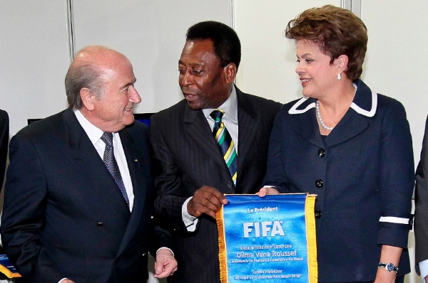 FIFA President Sepp Blatter, left, Honorary Ambassador of the 2014 FIFA World Cup Brazil Pele, center, and Brazil's President Dilma Rousseff smile during the Preliminary Draw of the 2014 FIFA World Cup Brazil in Rio de Janeiro, Brazil, Saturday July 30, 2011 [AP]