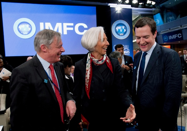 International Monetary Fund (IMF) Managing Director Christine Lagarde, center, speaks with Britain's Chancellor of the Exchequer George Osborne, right, and Governor of the Banque de France Christian Noyer, left, during the International Monetary and Financial Committee (IMFC) at World Bank Group-International Monetary Fund Spring Meetings in Washington, Saturday, April 12, 2014 [AP]