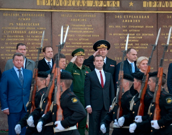 Russian Prime Minister Dmitry Medvedev, center, attends a wreath laying ceremony at the World War II memorial in Sevastopol, during his visit to Crimea, Monday, March 31, 2014 [AP]