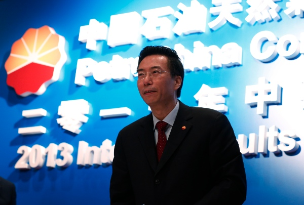 PetroChina President Wang Dongjin attends the company's interim results announcement in Hong Kong Thursday, Aug. 22, 2013. State-owned PetroChina's half-year profit rose to nearly $11 billion as Asia's biggest oil producer increased output of crude and natural gas [AP]