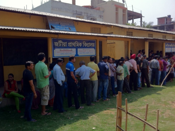Voters queue up at a polling booth in Guwahati, Assam on 24th April 2014 [TBP]