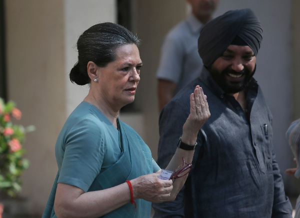 India's ruling Congress party President Sonia Gandhi, displays the ink mark on her finger after casting her vote during parliamentary elections in New Delhi, India, Thursday, April 10, 2014 [AP]