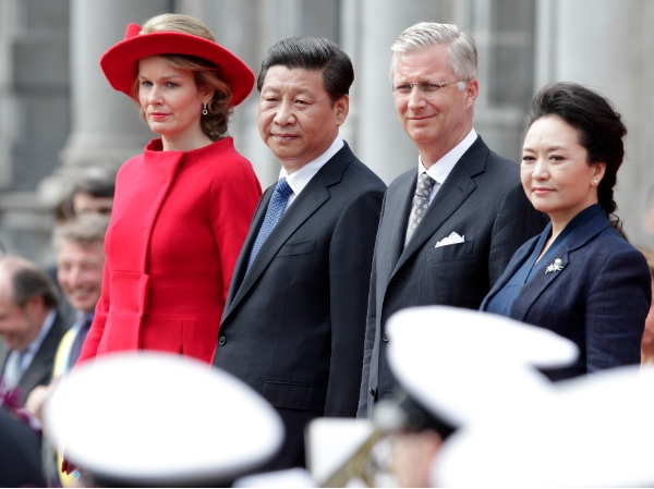 China's President Xi Jinping, second left, his wife Peng Liyuan, right, Belgian King Philippe and his wife Queen Mathilde, attend a ceremony on a podium at the Burg square in Bruges, Belgium, Tuesday, April 1, 2014 [AP]