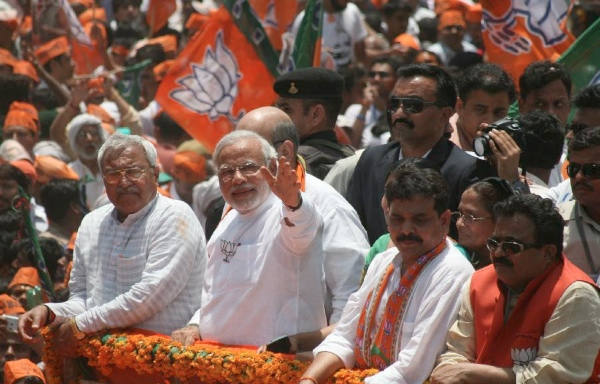 Narendra Modi (center) has delivered a rousing victory for India's main opposition Bharatiya Janata Party (BJP) in the 2014 general elections [Xinhua]