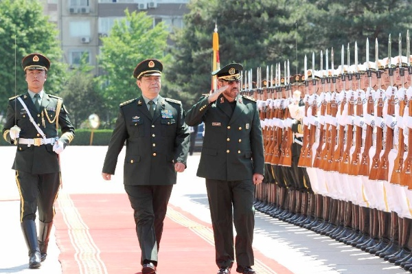 Chinese Defense Minister Chang Wanquan (L front) and Iranian Minister of Defense and Armed Forces Logistics Hossein Dehqan (R front) inspect the guard of honor before their talks in Beijing, capital of China, May 5, 2014 [Xinhua]