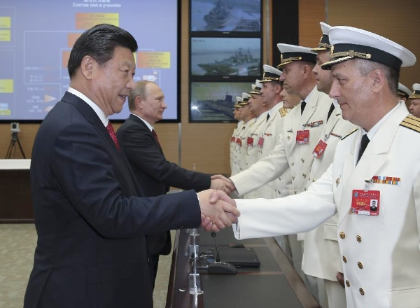 "Chinese President Xi Jinping (1st L) and his Russian counterpart Vladimir Putin (2nd L) shake hands with members of the naval forces from both sides before the launch ceremony of the China-Russia ""Joint Sea-2014"" exercise at Wusong naval port in Shanghai, east China, May 20, 2014 [Xinhua]"