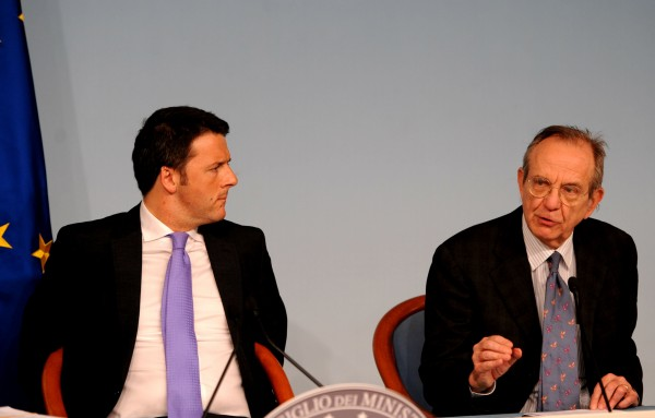 Renzi, left, and Padoan are likely to push for a change in EU public investment policies [Xinhua]