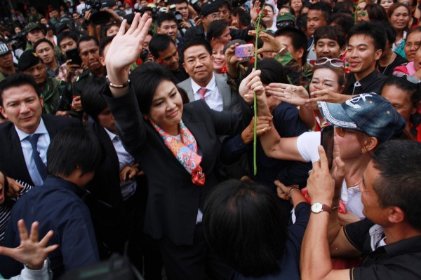 Yingluck bids farewell to her supporters after a constitutional court ruled she was to be removed from office [Xinhua]