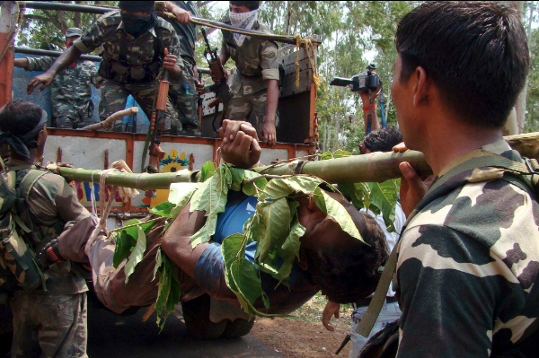 File photo of Indian security officers carrying the body of an alleged Maoist or Naxal fighter who was killed in a gunbattle with security forces in West Midnapore, West Bengal State, India June 16, 2010 [AP]