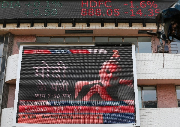 A portrait of India's next prime minister Narendra Modi is displayed on a screen on the façade of the Bombay Stock Exchange in Mumbai, India, Friday, May 16, 2014. Indian stocks jumped Friday as preliminary results from national elections indicated the pro-business opposition had won a landslide victory [AP]