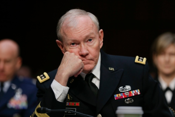 Joint Chiefs Chairman Gen. Martin Dempsey listens on Capitol Hill in Washington, Wednesday, March 5, 2014, while testifying before the Senate Armed Services Committee hearing focusing on the Defense Department's budget request for fiscal year 2015 [AP]