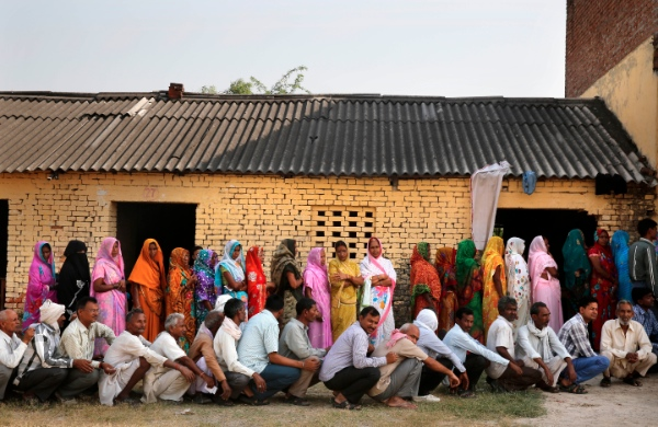 People wait in a queue to cast their votes at a polling station in Jaunpur, in the northern Indian state of Uttar Pradesh, India, Monday, May 12, 2014 [AP]
