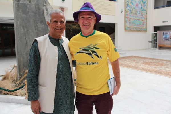 Muhammad Yunus (left) tells Helmo Preuss about how he has evolved into an incubator for businesses that solve problems [TBP]