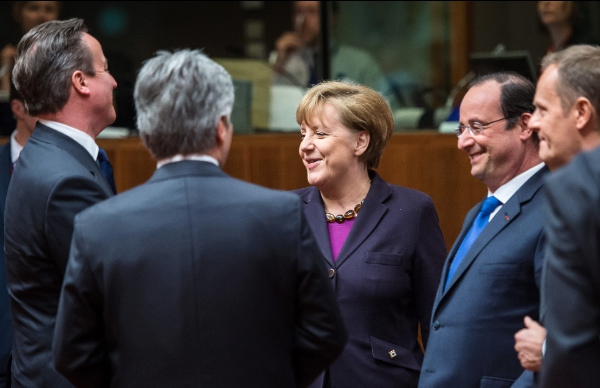 From left, British Prime Minister David Cameron, Austrian Chancellor Werner Faymann, German Chancellor Angela Merkel, French President Francois Hollande and Polish Prime Minister Donald Tusk speak with each other during a round table meeting an EU summit in Brussels on Thursday, March 20, 2014 [AP]