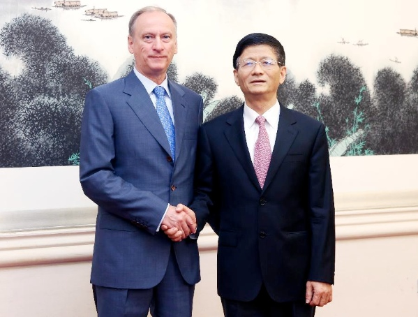 Meng Jianzhu (R), a member of the Political Bureau of the Communist Party of China (CPC) Central Committee and head of the Commission for Political and Legal Affairs of the CPC Central Committee, and Russian Security Council Secretary Nikolai Patrushev attend the first meeting of a cooperative mechanism on security and law enforcement between China and Russia, in Beijing, capital of China, June 5, 2014 [Xinhua]