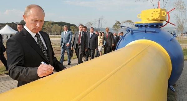 File photo of Russia's President Vladimir Putin signing an autograph on a natural gas pipeline [Getty Images]