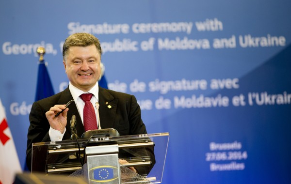 Poroshenko called the trade pact a historic event for Ukraine, but analysts warn a political rift with Russia could widen [Xinhua]
